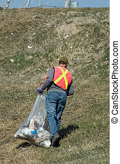 Garbage Picker - A man wearing a reflective vest, picking up...