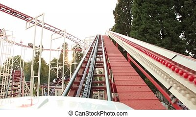 roller coaster going up the hill