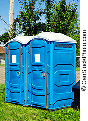 Portable toilets on grass - Two portable toilet or loo in...