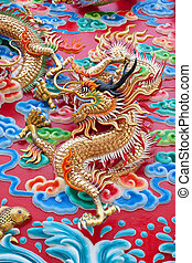 chinese dragon statue on temple wall in Thailand