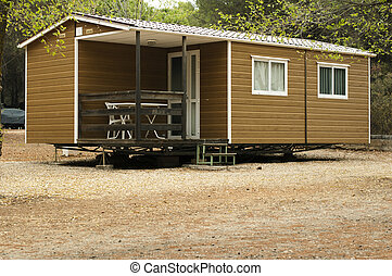 Mobile homes, brown bungalow in a camping.