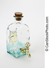Glass bottle with tap.