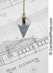 Plumb bob. - Plumb bob on architectural drawing.