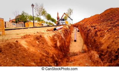 Loader Excavator working in a construction site, tilt shift...