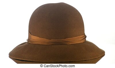 Brown vintage hat on white background.