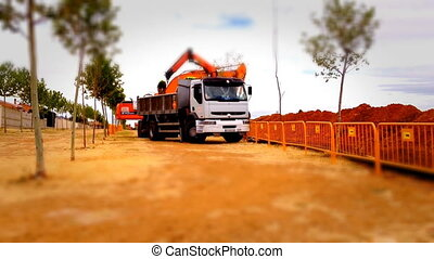 Loader truck working in a construction site, tilt shift...