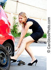 broken down car - Beautiful young woman near the broken car