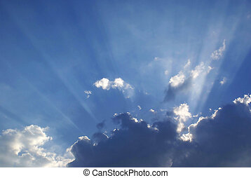 Sunbeams. - Rays of the sun from behind a cloud.