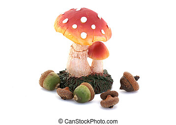 Acorns and a toadstool. - An autumn picture, nuts around a...