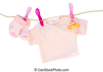 baby girl clothes hanging on rope - baby pink clothes...