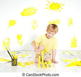 Child playing with construction blocks.