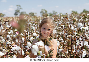 Portrait of a girl in a field of cotton - Portrait of a...