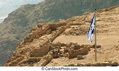 Flag of Israel in Masada - ancient fortress at the...