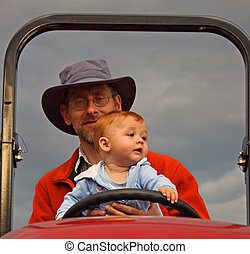 Little guy driving a farm tractor - a little toddler, 8...