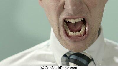 Angry man shouting at camera
