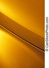 golden curve - curved vehicle panel abstract of glittering...