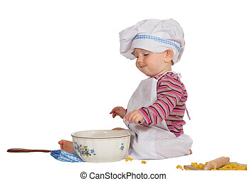 Satisfied little baby chef looking at mixing bowl -...