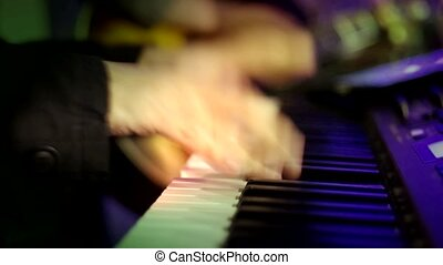 Hand Playing Piano with Lighting - Hand of the Pianist...