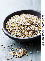 lentils - bowl of uncooked green lentils