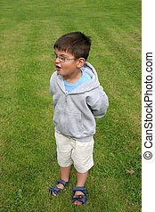 Surprised Little Boy - Young boy wearing glasses with a...
