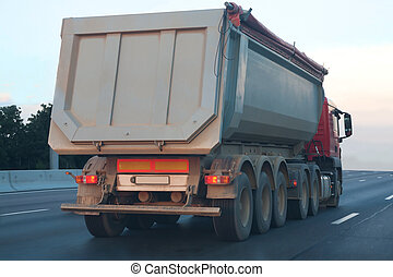 dump truck goes on highway - big dump truck goes in the...