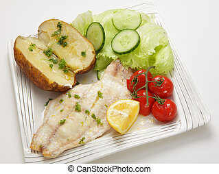 Baked fish fillet meal - Close-up on an oven baked white...