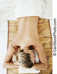 wellness - female ready for massage or other wellness...