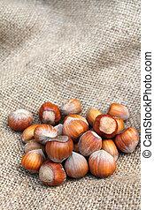 Hazelnuts on sacking background