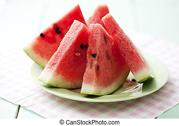 watermelon slices - plate with freshly cut watermelon