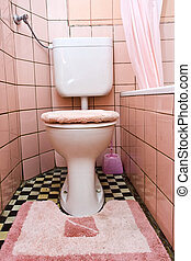 Dirty toilet - Dirty old  toilet with pink ceramic tiles