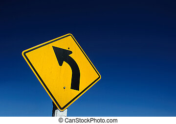 Curved Road Traffic Sign over on blue sky