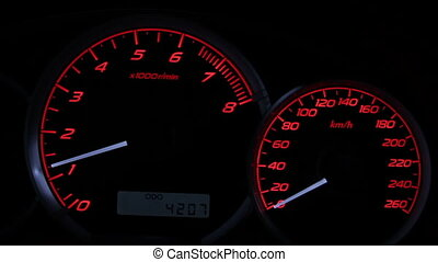 Car speedometer and Tach - a sports car instrument panel,...