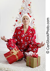 christmas stress relief - young female in christmas pajamas,...