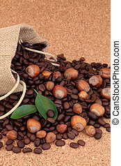 Hazelnut Coffee - Hazelnut fruit with coffee beans in a...