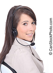 Studio shot of young woman with a headset