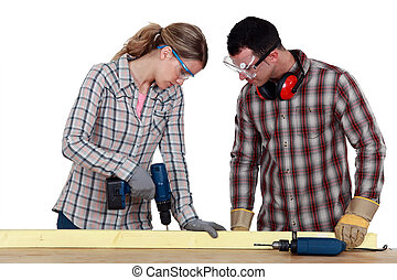 Couple drilling wood
