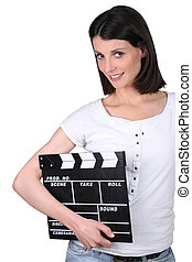Woman holding a clapperboard