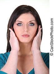 Woman covering ears