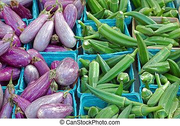 okras and eggplants in buckets in farmer market