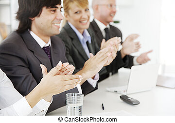 business success - business team applauding at a conference...