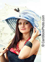 Young lady in hat with an umbrella
