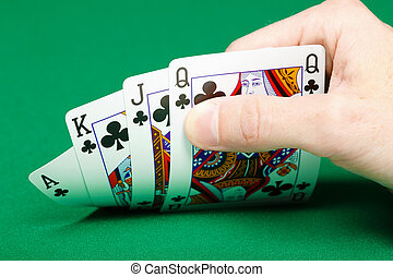man's hand with four cards