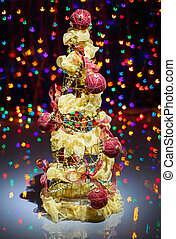 Christmas tree decorated on black multicolored sparkling background