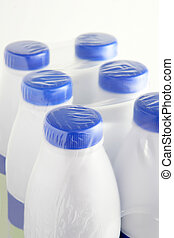 Six plastic bottles of milk