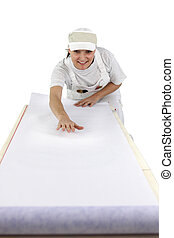 Woman rolling out wallpaper