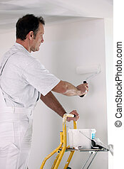 Decorator working on DIY project