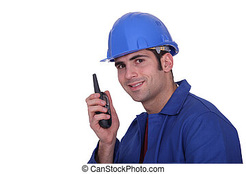 Construction worker with a two-way radio