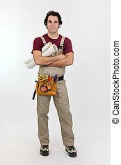 Decorator holding rolls of wallpaper