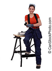 Woman with a tile cutter