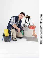 young tiler working